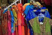 Colorful clothes adorn the racks at Cosmos Indian Store.