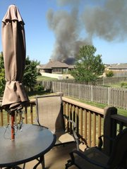 Picture submitted via Twitter of grass fire threatening homes near Langston Hughes School in Lawrence on George Williams Way. Photo is from a backyard in 1000 block of Stonecreek Drive.