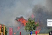 Online submitted photo of grass fire near Langston Hughes Elementary School.