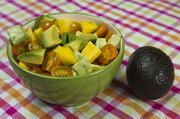 Nutritious: Mix up fresh ingredients for an avocado, tomato and mango salad.