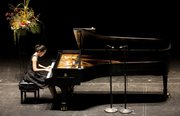 Fourteen-year-old Chaeyoung Park, of Lawrence, begins with Clementis Sonata in F-sharp minor during the semifinal round of the International Institute for Young Musicians piano competition July at the Lied Center.