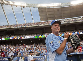 KU basketball coach Bill Self, pounds his glove and takes in the All-Star atmosphere before starting at second base for the American League in the All-Star Legends & Celebrity Softball Game Sunday, July 8, 2012, at Kauffman Stadium.