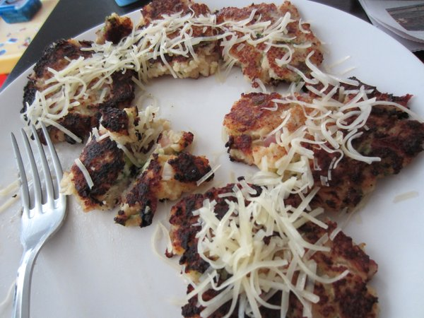 The hubby's favorite potato pancakes, covered in cheese.