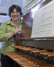 Elizabeth Egbert Berghout, is the Kansas University carrilloneur. She plays weekly recitals on the carillon as well as performing for special events like commencement. The 120-foot Campanile, contains the 53-bell carillon and was dedicated on May 27, 1951, and rededicated on April 26, 1996, following an extensive renovation.