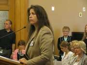 Teresa Williams, acting commissioner of the Juvenile Justice Authority, speaks Tuesday to members of the Legislative Post Audit Committee about a report that showed problems at the Kansas Juvenile Correctional Complex in Topeka. Williams acknowledged serious problems at the facility and said she was committed to fixing them.