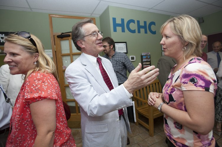 U.S. Health and Human Services Acting Regional Director Jay Angoff visits with Allison Veeder, an advanced practice registered nurse with Heartland Community Health Center, during a reception Wednesday, July 11, 2012, at Heartland. Angoff applauded the health center for its efforts to care for anyone regardless of their health status and ability to pay. In June, HHS announced that Heartland would receive a renewable, annual grant of $650,000 as part of being named a Federally Qualified Health Center. Pictured at left is Cindy Hart, of Bert Nash Community Mental Health Center.