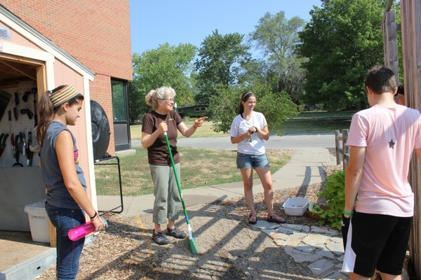 "Nancy O'Connor, director of the ""Growing Food, Growing Health"" project, talks about the project's first 5K fundraiser which will be July 28. The event will benefit gardens at West Middle School and Sunset Hill and Hillcrest elementary schools. O'Connor was discussing the event during a garden workday on Wednesday, July 11, 2012, at West Middle School. Listening, from left, are Hayley Luna, Martha Allen and TJ Everett."