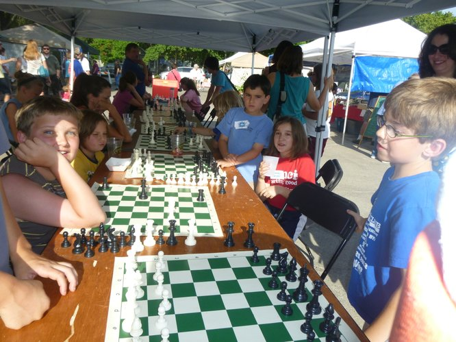 Students from more than to 10 area schools play together at Cottin's Hardware Farmers Market thanks to the Cordley Elementary School Chess Club and their parents!