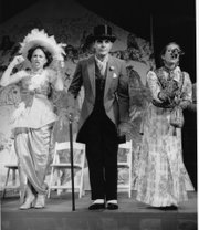 From left, Julia Geisler as Eliza Doolittle, Eddie Schube as Freddy Eynsford Hill and Sara Kennedy as Mrs. Eynsford Hill perform a scene in Kansas University Theatre&#39;s production of &quot;My Fair Lady.&quot;