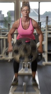 Bodybuilder Tina Hawkins lifts weights to strengthen back muscles during training Friday, July 13, 2012, at the Lawrence Athletic Club. Hawkins will be competing in a national competition in Pittsburgh at the end of August.