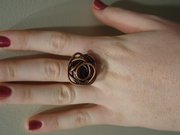 Knotted ring: Female version found at Phoenix Gallery for $29.