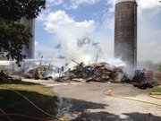 Two hay barns were destroyed by a Tuesday afternoon fire at 2160 N. 1150 Road, two miles south of Eudora.