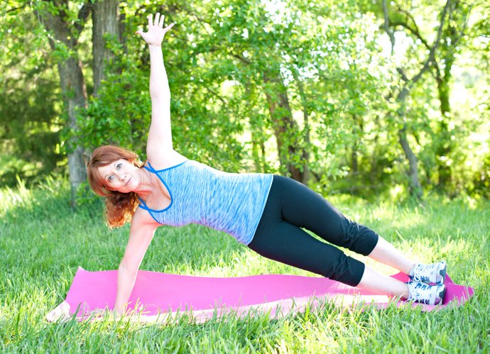 For the side plank, keep a straight line from head to heels and extend the top arm above the shoulder.