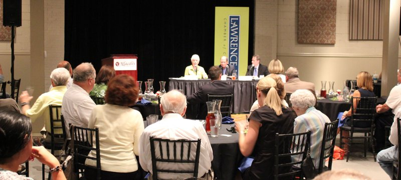 About 60 people attended a panel discussion about federal health reform Thursday, July 19, 2012, at Maceli's in downtown Lawrence. The panelists are, from left in front, Kansas Insurance Commissioner Sandy Praeger, Lawrence Memorial Hospital President and CEO Gene Meyer, and Michael Williams, of UnitedHealthcare of Kansas City.