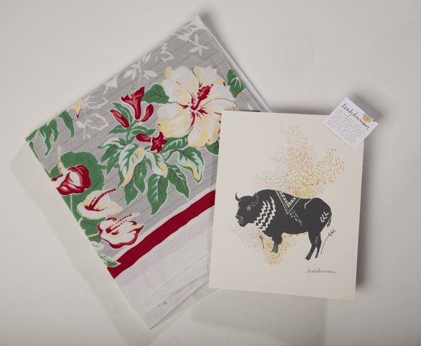 Home decor finds from the Downtown Lawrence Sidewalk Sale: vintage tablecloth from Blackbird Trading Post ($16) and 8-by-10-inch buffalo print, by Austin-based artist Leah Duncan, from Wonder Fair ($12)