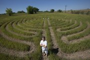 David Bartholomew is pictured before a labyrinth created he created with his wife, Joan Clark, at 1661 E. 400 Road, west of Lawrence. Bartholomew hopes the labyrinth will be used as a place of meditation.