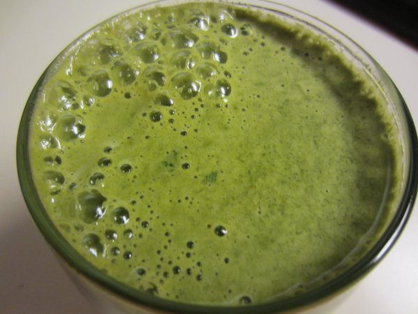 Green juice with local summer squash, carrots and cucumber.