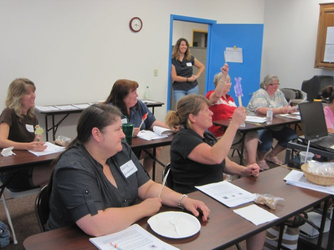 At a What's On Your Plate training, early educators partake in the Little Red Hen story