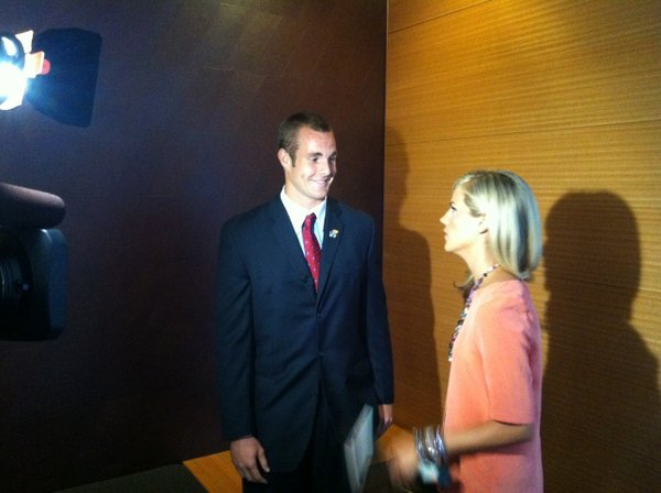Kansas quarterback Dayne Crist talks with ESPN's Samantha Steele before an interview on Tuesday at Big 12 media days in Dallas.