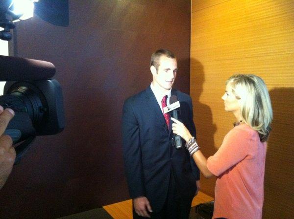 Kansas quarterback Dayne Crist talks to ESPN's Samantha Steele during an interview at Big 12 media days on Tuesday in Dallas.