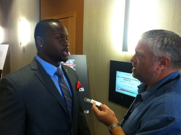 Kansas defensive end Toben Opurum talks to a reporter on Big 12 media days on Tuesday in Dallas.