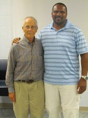 Former LHS football coach Bill Freeman, left, stands with ex-LHS player Gary Oatis.