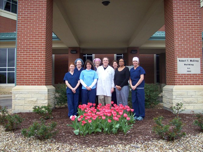 Staff at Tallgrass Surgery Center in Topeka admire their pink ribbon tulip garden that bloomed this spring from Plant It Pink tulip bulbs.