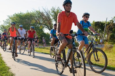 Bicyclists take off during the second annual Lawrence Community Bike Ride on Saturday, July 21, 2012, at the Rotary Arboretum. About 200 participated in the event, which had three rides: one mile, three miles and 10 miles.