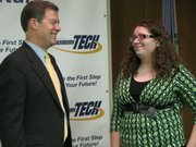 Gov. Sam Brownback on Thursday speaks with Olivia Schwyhart of Lawrence after a news conference on the state's new career and technical education law.