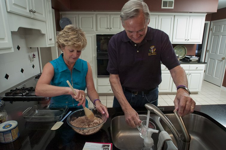 Former Rep. Dennis Moore and his wife, Stephene Moore, make a batch of brownies together recently at their Lenexa home. Moore, a six-term congressman, announced earlier this year that he had been diagnosed with Alzheimer's disease.