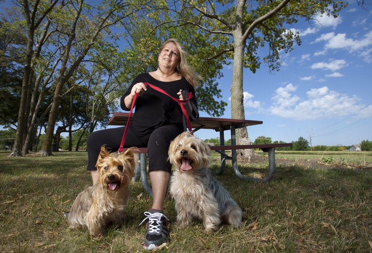 Lawrence resident Maureen Bernhagen, who is pictured with her dogs Cosmo, left, and Taza, would like to see a fenced dog park be added to the south side of Peterson Park at the corner of Peterson Road and North Iowa Street. Bernhagen says she has a petition with 375 signatures, which was presented to the Lawrence Parks and Recreation Department board earlier this month.