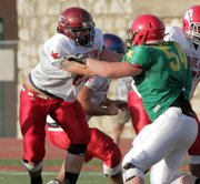 Eudora lineman Greg Snell, left, playing for the East, blocks West tackle Matt Seiwert (54) of Conway Springs at the 2012 Kansas Shrine Bowl, Saturday, July 28, 2012, at Emporia.