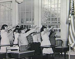 The Bellamy salute during the American Pledge of Allegiance (1920s and 1930s).