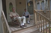 Paul Wood, left, and his son, Jason, pictured at their home at 1108 Conn., moved from California to Lawrence in 2000 after Jason was critically injured in a cycling accident. In 2005, they moved into their current residence with the help of Tenants to Homeowners, an organization that helps low-income families find affordable housing.