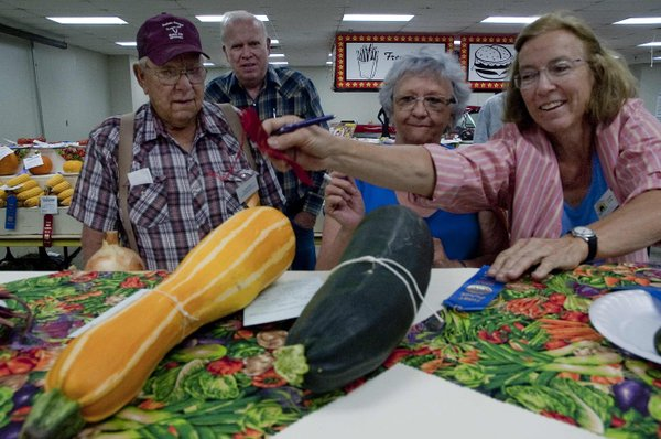 From left, judges Jim Springer, Lyle Turner, Barb Copple and Susan Randall judged the veggies at the Douglas County Fair on Tuesday morning.