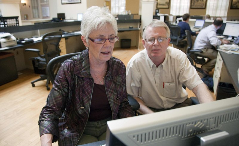 Kansas Insurance Commisioner Sandy Praeger, left, participates in an online chat Wednesday, Aug. 1, 2012, in The News Center while public information officer Bob Hanson looks on. Praeger answered questions about federal health reform.