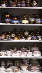 One storage cabinet at the Spencer Museum of Art contains shelves filled with English copper lustreware. The lustreware is among the tens of thousands of pieces the museum has in storage.