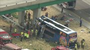 This photo from video provided by KSDK-TV NewsCenter5 in St. Louis, shows the scene near Litchfield, Ill., where a double-decker Megabus struck a concrete bridge pillar along Interstate 55 in southern Illinois. There was no immediate word of injuries in the Thursday afternoon wreck.