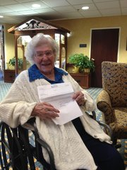 Edna Zillner shows off the letter she received from Gov. Sam Brownback congratulating her on her birthday. Zillner turned 105 on Friday.
