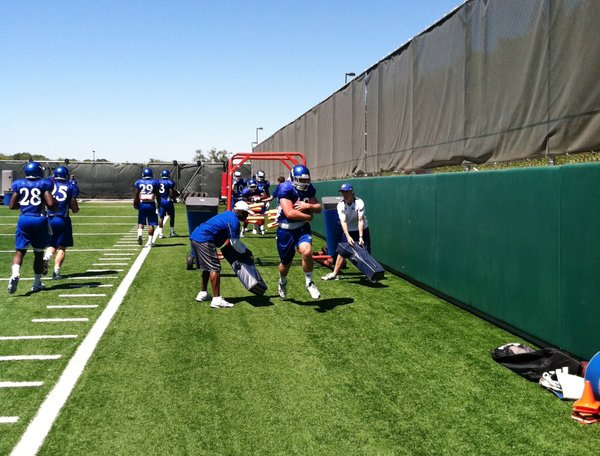 KU's running backs run the gauntlet during the opening portion of Sunday's practice.