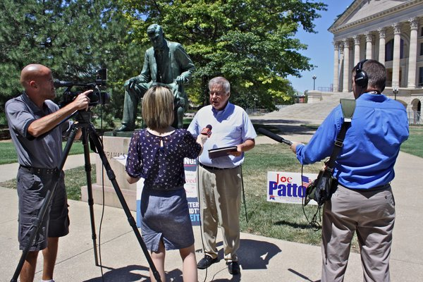 On Monday, Rep Joe Patton, a Topeka GOP conservative who is challenging incumbent State Sen. Vicki Schmidt, also a Republican, called a press conference demanding that local stations withdraw TV ads that question his conservative credentials and point out that he once was a registered Democrat.