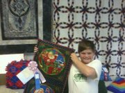 Adam Leonard, 11, had his quilting project for the Douglas County Fair, a Christmas wall hanging, stolen along with a few other projects last weekend. His family is asking the person to return it anonymously so he can enter it in the Kansas State Fair in September.