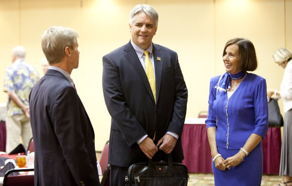 Roy Jensen, director of the Kansas University Cancer Center, middle, talks with Lawrence Noon Rotary Club president Scott Morgan, left, and Rotary board member Beverly Billings on Monday, Aug. 6, 2012, before anmeeting at the Holiday Inn Lawrence. Jensen spoke about the center's recent National Cancer Institute designation and its plans for the future.