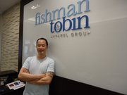Donald Lee is a former employee of ACME, 847 Mass., who now works for Fishman & Tobin in New York designing T-shirts for Tommy Hilfiger.