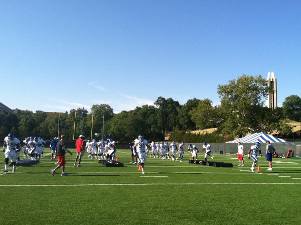 The KU defense gets warmed up on a pleasant Tuesday morning on the first day of two-a-days.
