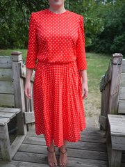 A vintage dress, shown, from Salvation Army, 1601 W. 23rd St., was turned from a matronly frock into separates offering many options with a few simple cuts and stitches.