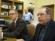 House Minority Leader Paul Davis, D-Lawrence, and Senate Minority Leader Anthony Hensley, D-Topeka, on Wednesday say moderate Republicans and independents should join Democratic efforts to fight Gov. Sam Brownback's agenda.