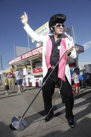 Mike Yoder/Journal-World Photo.I placed Elvis impersonator Wade Morrow in a setting at the Douglas County Fair but the afternoon sunlight was so direct and harsh I added a flash to what would have been a shaded side of his face. I placed an off-camera flash to the front and on his left side at about 8-feet away at 6-feet high and angled slightly down. My flash was powerful enough to match the sunlight and give me an exposure that helped increase the blue of the sky. On-camera flash can be used in a similar way in outdoor situations. 