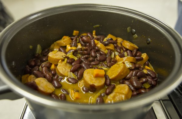 Participants in a Just Food cooking class created a red bean mixture to put over rice and top with pico de gallo.