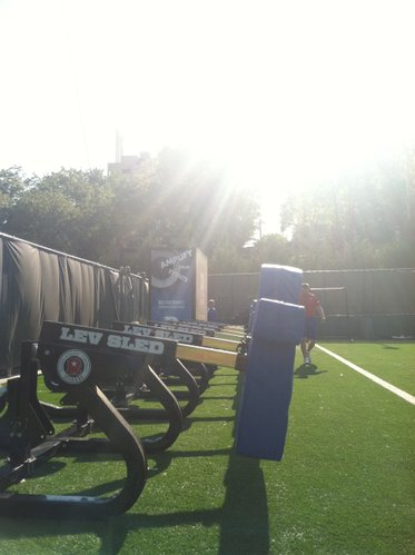 The sled sits just beyond the end zone, shortly after KU's O-Line, rotating in, pushed the thing more than 50 yards during a pre-practice drill Thursday morning. That big box behind the sled? That's the new sound system.